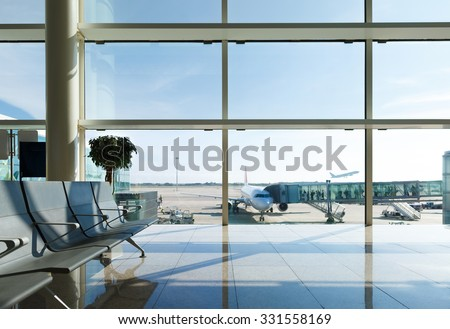 Airport terminal, people going to airplane in background Royalty-Free Stock Photo #331558169