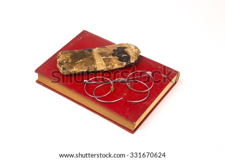 Old book and vintage glasses  isolated on white background  #331670624