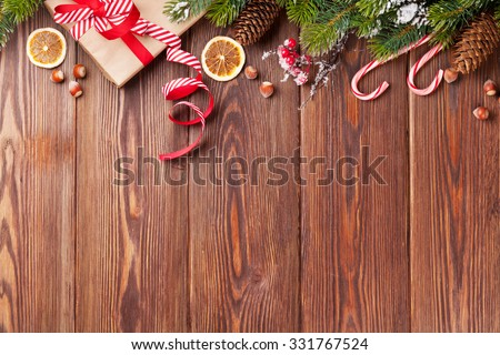 Christmas gift box, food decor and fir tree branch on wooden table. Top view with copy space #331767524