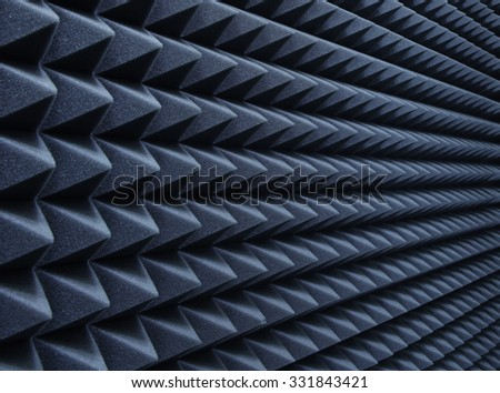 Dampening acoustical foam on recording studio wall