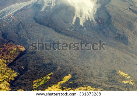 huge total of vulcan lava covering a enormous site near tungurahua volcano in ecuador canyon tree vegetation summertime scenery outdoor grass ecuador rain forest landscape woods tour wild vista mounta #331873268