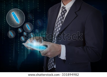 Businessman hand touch pen icons on a tablet. #331894982