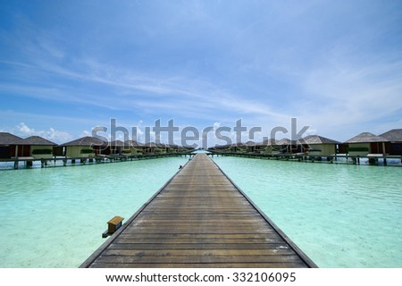 Over water bungalows with amazing green and poor sea #332106095