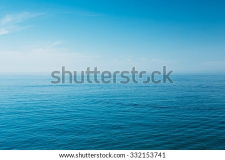 Calm Sea Ocean And Blue Sky Background Royalty-Free Stock Photo #332153741
