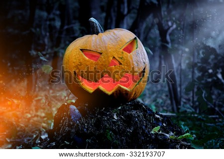 Glowing Pumpkin in the forest. Jack O Lantern for Halloween #332193707