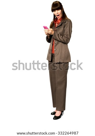 Shocked Caucasian woman with long dark brown hair in business formal outfit using mobile phone - Isolated #332264987