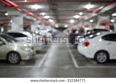 Blur image, Underground parking with cars. #332284775