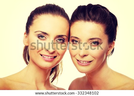 Two attractive sisters with make up. #332348102