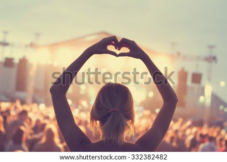 She loves this band! Royalty-Free Stock Photo #332382482
