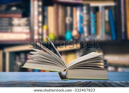 Open book on a bookshelf #332407823