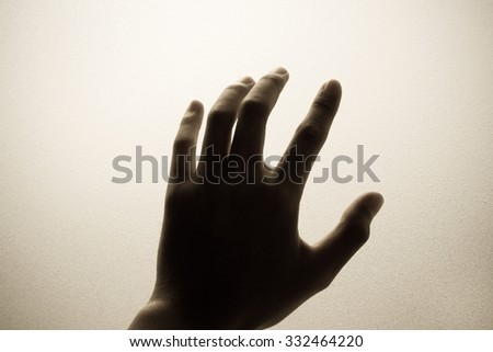 hand touching frosted glass Royalty-Free Stock Photo #332464220