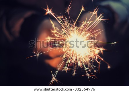 bright festive Christmas sparkler in hand toning #332564996