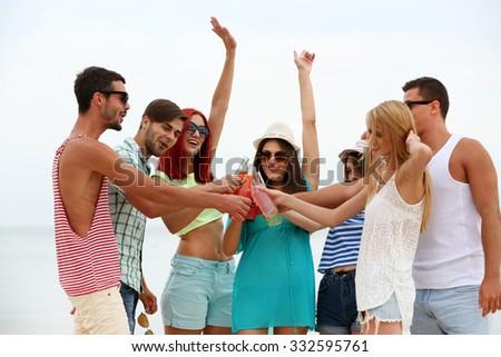 Beautiful young people having fun on beach #332595761