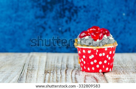 Colorful cupcakes on a wooden background #332809583