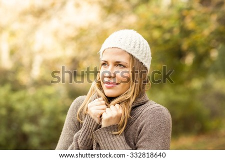 Pretty woman holding her scarf on an autumns day #332818640