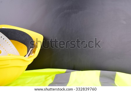 Work Place Safety Concept with safety equipment and a blackboard in the background #332839760