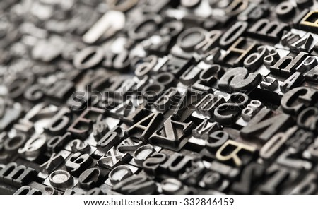 Letterpress background, close up of many old, random metal letters with copy space Royalty-Free Stock Photo #332846459