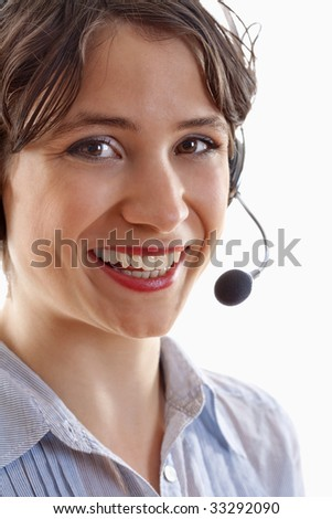 business - young brunette woman with headset on her head #33292090