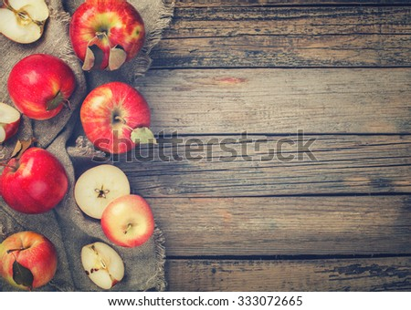 Fresh red apples on wooden background.Toned image. Vintage style.Copy space.selective focus.