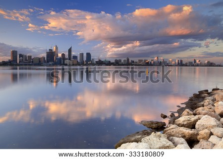 The skyline of Perth, Western Australia at sunset. Photographed from across the Swan River.
