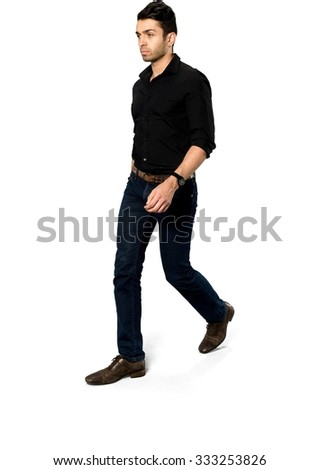 Serious Caucasian with short dark brown hair in casual outfit walking - Isolated #333253826