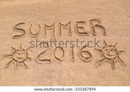 """In the picture the words on the sand """"Summer 2016""""."""