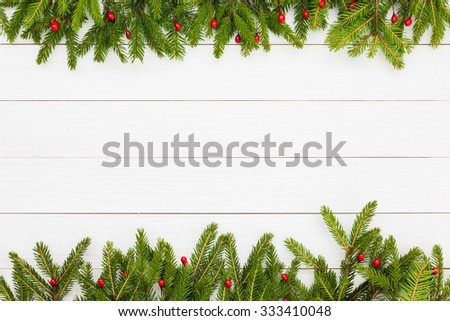 Christmas background. Christmas fir tree with decoration on white wooden board background with copy space  #333410048