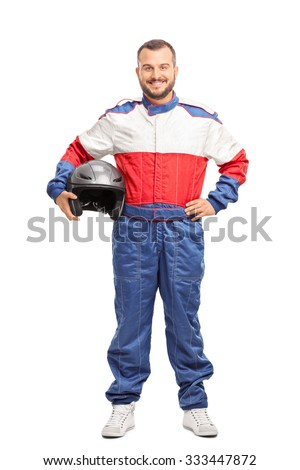 Full length portrait of a young male car racer in overalls holding a helmet and looking at the camera isolated on white background Royalty-Free Stock Photo #333447872