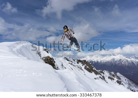 Flying snowboarder on mountains, extreme winter sport #333467378