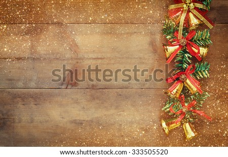 image of christmas festive decorations on wooden background. retro filtered