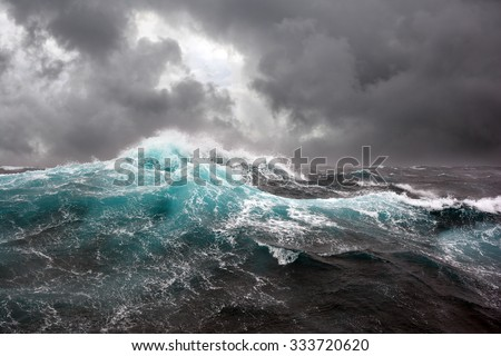 sea wave and dark clouds on background Royalty-Free Stock Photo #333720620