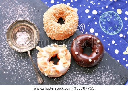 Donuts on stone plate , sugar powder, and space #333787763