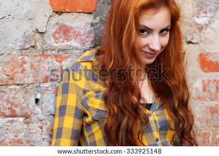 red-haired girl in a hat hipster #333925148