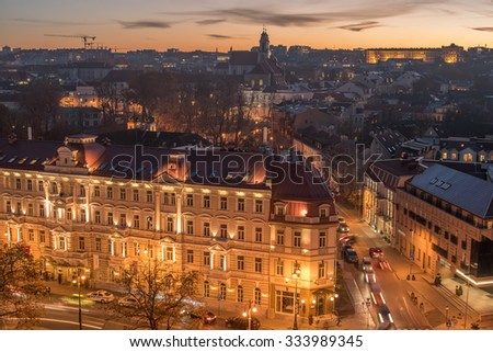 Aerial view of Vilnius, Lithuania in the beautiful sunset of the autumn. Beautiful historical buildings next to Cathedral Square. Church of St. Catherine (Sventos dvasios baznycia) in the background. #333989345