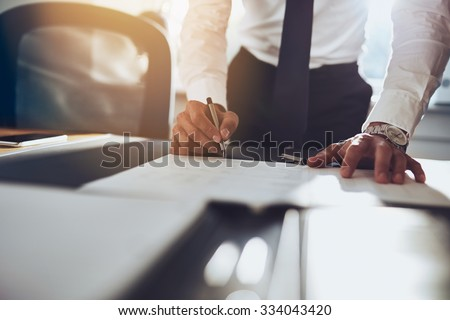 Close up business man signing contract making a deal, classic business #334043420