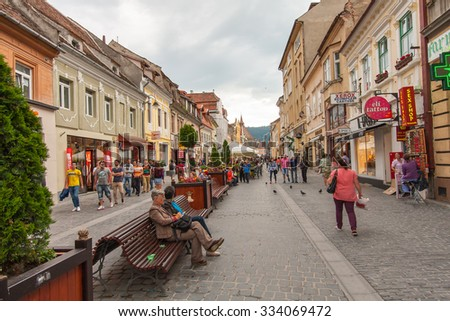 Brasov, Romania-July 03, 2015:  The renovated market square. Flock of Tourists walking on the main square of the city #334069472
