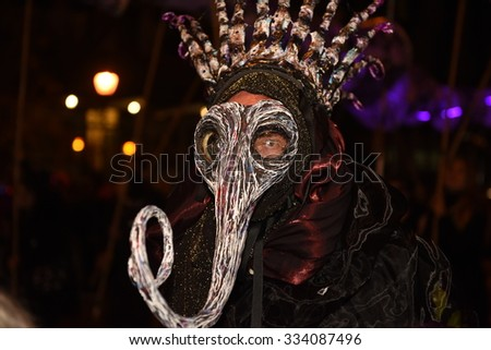 NEW YORK CITY - OCTOBER 29 2015: The 42nd annual Halloween parade filled 6th Avenue in the West Village with costumes, floats & weekend revelry #334087496