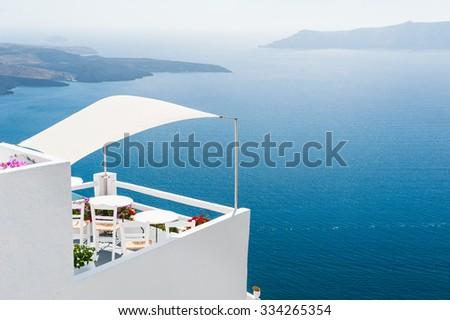 White architecture on Santorini island, Greece. Beautiful landscape with sea view. #334265354
