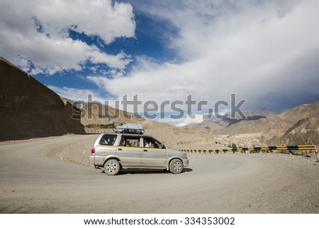 LEH LADAKH , INDIA - AUGUST 8 : The high way road and car in Himalayan mountain in Leh Ladakh,India on August 8, 2015. #334353002