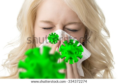 Portrait of a ill blond woman who is sneezing virus in a tissue #334372274