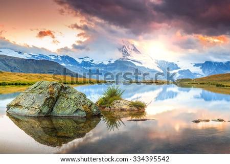 Stunning panorama with Matterhorn and beautiful alpine lake,Stellisee,Valais region,Switzerland,Europe #334395542