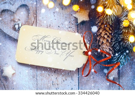 Christmas background with tree light and Christmas paper card