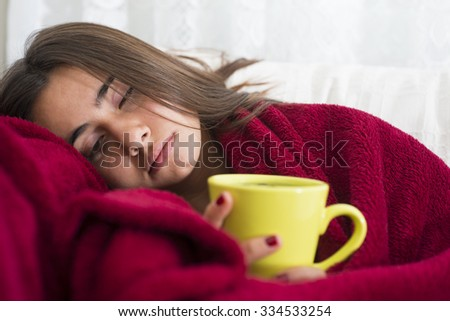 ill young girl with fever drinking cup of warm tea Royalty-Free Stock Photo #334533254