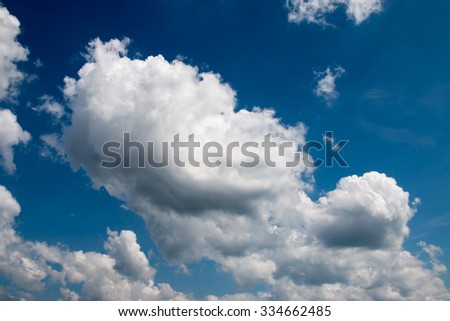 Fantastic soft white clouds against blue sky #334662485