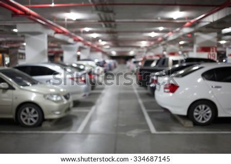 Blur image, Underground parking with cars. #334687145
