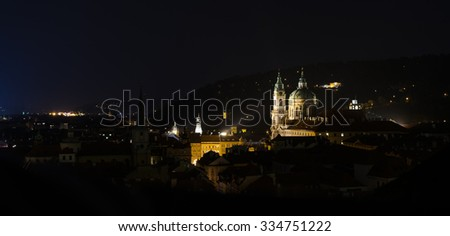 view of the old town with a church and tower illuminated late autumn evening #334751222