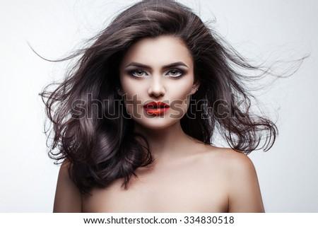 portrait of a beautiful brunette on a light background #334830518