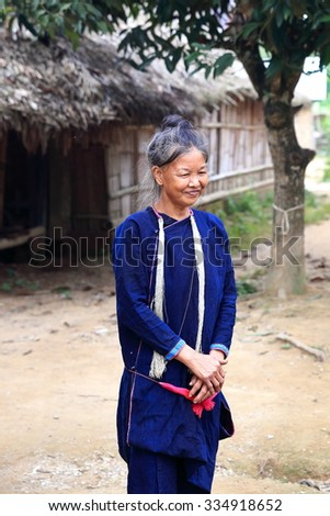 MUANG KHUA,LAOS-OCTOBER 07, 2015:  Local come to receive visits by tourists out of curiosity on October 07, Muang Khua, Laos. #334918652