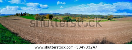 Panorama of foothill valley in the autumn.Saxon Switzerland, Germany.Toned image. #334933247