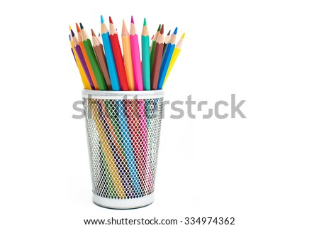 Colored pencils in a pencil case on white background Royalty-Free Stock Photo #334974362
